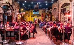 People eat at Dr Shakshuka. Tel Aviv, Israel - March 28, 2019: People eat at Dr Shakshuka, best cafes and restaurants of the city in old Jaffa, Tel Aviv, Israel stock image