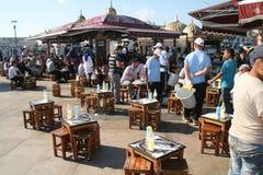 People eat fish in Eminonu, Istanbul Stock Photos