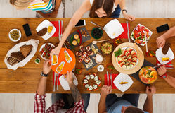 People eat healthy meals at festive table dinner party Royalty Free Stock Image