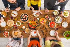 People eat healthy meals at served table dinner party Stock Images