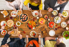 People eat healthy meals at served table dinner party. Friends dinner table top view. People eat healthy food together, home party Stock Images
