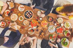 People eat healthy meals and talk at served table dinner party Stock Images