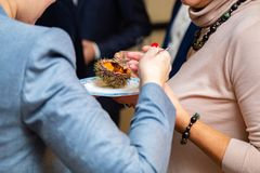 People eat sea urchin in a restaurant. Close-up royalty free stock images