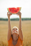 People eat watermelon. And enjoy royalty free stock images