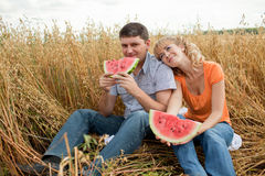 People eat watermelon Royalty Free Stock Photos