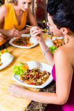 People eating in Asia restaurant Royalty Free Stock Photography