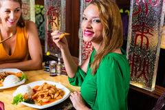 People eating in Asia restaurant Royalty Free Stock Images