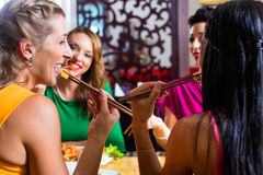 People eating in Asia restaurant Stock Image