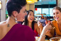 People eating in Asia restaurant Stock Photo