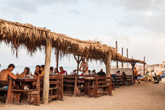 People eating on a beach restaurant Stock Image