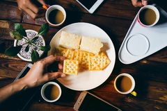 people are eating biscuits royalty free stock image