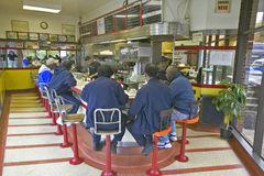People eating breakfast at diner counter. At old Waffle Shop in Washington DC Royalty Free Stock Image