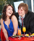 People eating cake in restaurant. Stock Photo