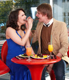 People eating cake in restaurant. Stock Images