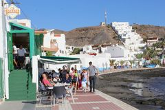 People outdoor restaurant terrace beach, Las Playitas, Fuerteventura Stock Photography