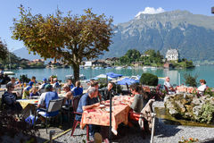 People eating and drinking on a restaurant of Iseltwald Stock Image