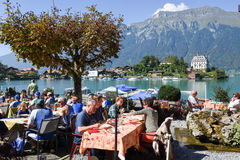 People eating and drinking on a restaurant of Iseltwald Royalty Free Stock Photography