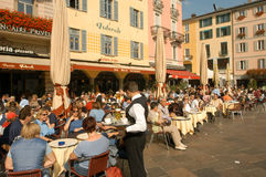 People eating and drinking at restaurants Royalty Free Stock Photography