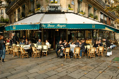 People eating and drinking in a street restaurant of Paris Stock Images