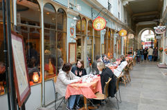 People eating and drinking in a street restaurant of Paris Stock Image