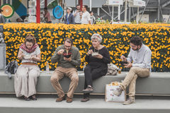 People eating at Expo 2015 in Milan, Italy Stock Photo