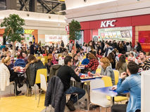 People Eating Fast-Food At Kentucky Fried Chicken Restaurant Royalty Free Stock Photography