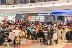 People Eating Fast-Food At McDonald's Restaurant. BUCHAREST, ROMANIA - JANUARY 02, 2015: People eating unhealthy fast-food from McDonald's Restaurant In Shopping Royalty Free Stock Photography