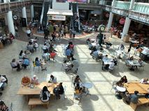 Food Court. People eating fast food products in the food court in the Scottsdale mall in Scottsdale Arizona stock image