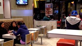 People eating food at mcdonalds fast food restaurant stock video