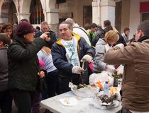 People eating grilled calsot at streets in Valls Stock Photos