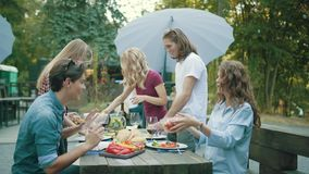 People Eating Healthy Food On Outdoor Party.