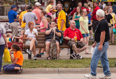 People eating at the Iowa State Fair. DES MOINES, IA /USA - AUGUST 10: Attendees at the Iowa State Fair. Unidentified people enjoy food at the Iowa State Fair on Stock Images