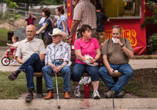 People eating at the Iowa State Fair. DES MOINES, IA /USA - AUGUST 10: Attendees at the Iowa State Fair. Unidentified people enjoy food at the Iowa State Fair on Stock Photography