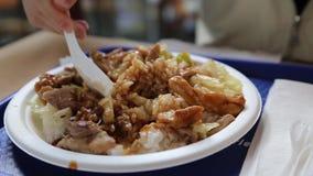 People eating Japanese food called teriyaki chicken. stock footage