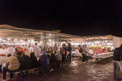 People eating in Marrakesh main square at night Stock Images