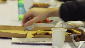 People eating meals and drinking alcohol. Ending party. Unhealthy food. Stock footage stock footage
