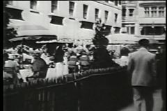 People eating in outdoor cafe, New York City, 1930s stock video footage