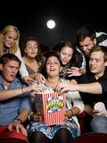 People eating popcorn Stock Photos