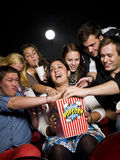 People eating popcorn Stock Photo