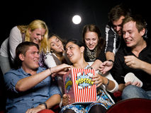 People eating popcorn Stock Image