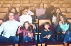 People eating popcorn in cinema Stock Photos