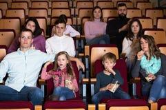 People eating popcorn in cinema Royalty Free Stock Photos