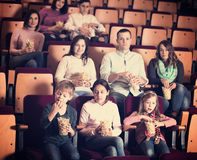 People eating popcorn in cinema Royalty Free Stock Photography