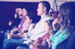People eating popcorn in cinema Royalty Free Stock Image