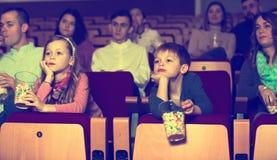 People eating popcorn in cinema Stock Image