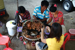 People eating popular street food of animal giblet, Myanmar Stock Photo