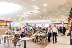 People Eating At Restaurant In Luxury Shopping Mall Interior Stock Photo