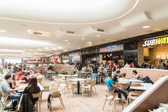 People Eating At Restaurant In Luxury Shopping Mall Interior Stock Photography