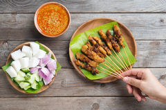 People eating satay Stock Images