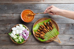 People eating sate Stock Photos